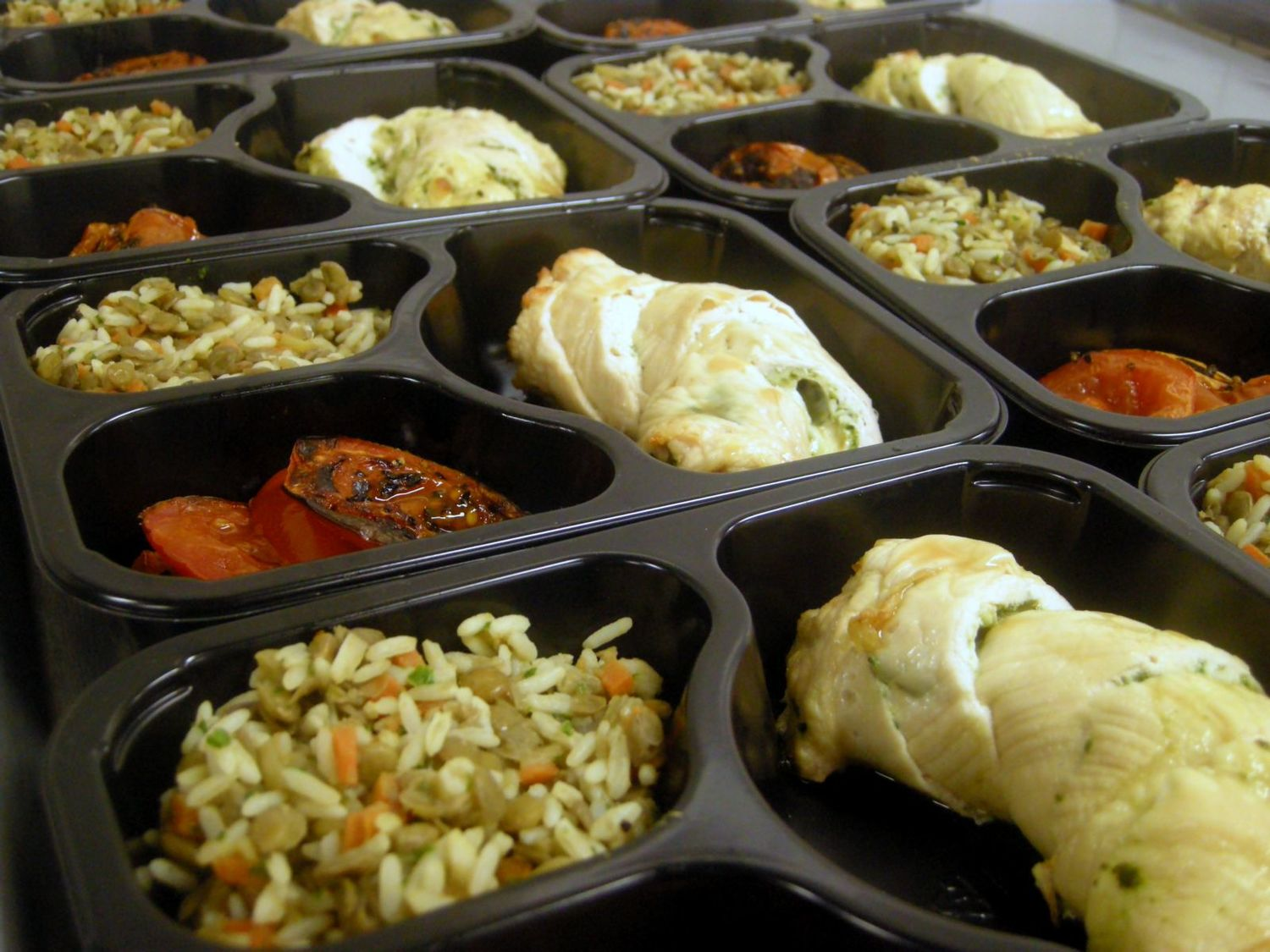 Prepared meals on a table ready to be sent out.