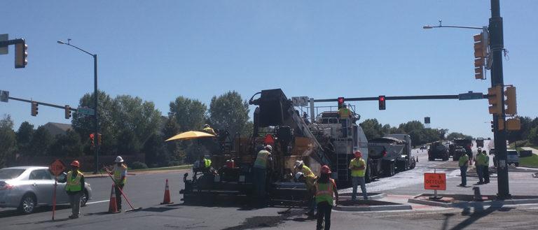 A construction crew resurfacing a road.