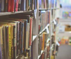 Books on a library shelf.