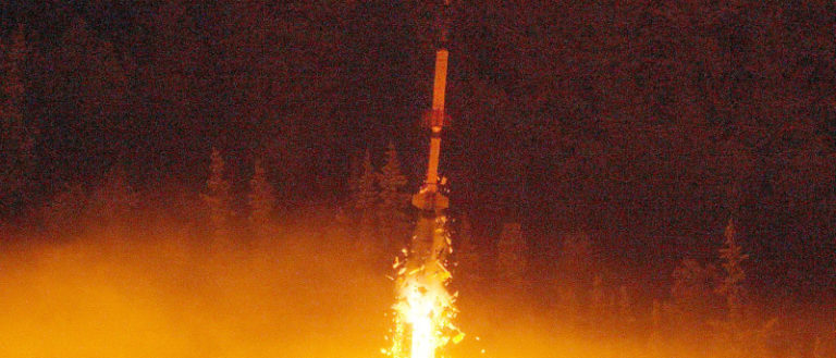 A sounding rocket being launched into space.