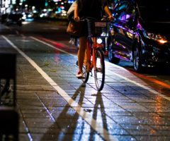 A person bicycling in a bike lane.