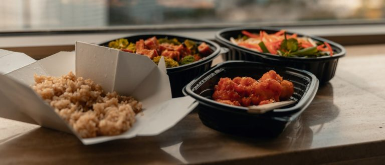 Containers of takeout food from a restaurant.