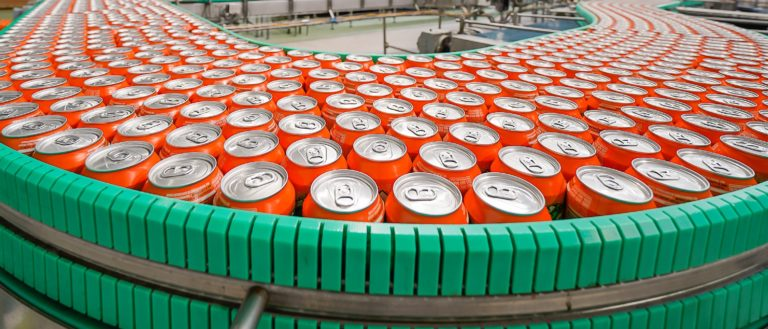 A manufacturing line canning soda.
