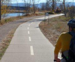A person biking on a greenway trail.