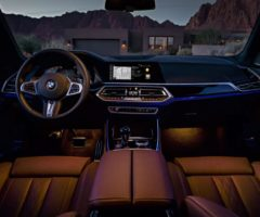 A lit interior of a BMW vehicle.