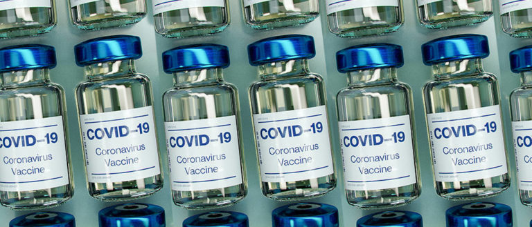 Bottles of COVID-19 vaccines.
