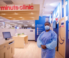A health care worker standing in a CVS MinuteClinic.