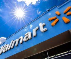 The Walmart logo on a blue building.