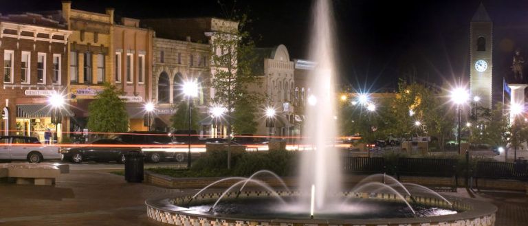The Morgan Square fountain lit up at night in downtown Spartanburg.