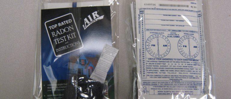 A radon test kit on a table.