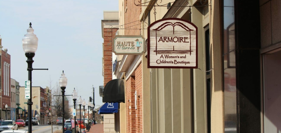 Local business entrances along the sidewalk in downtown Spartanburg.