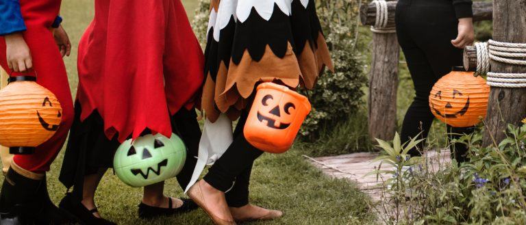 Children in costumes trick-or-treating for Halloween.