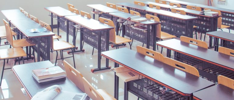 Empty desks in a school classroom.