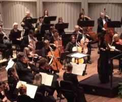 The Spartanburg Philharmonic orchestra on stage during a performance.