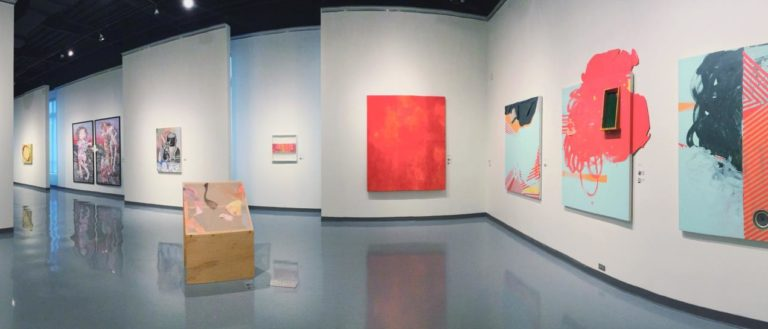 A panorama of the Traditions Compounded exhibit at Spartanburg Art Museum.