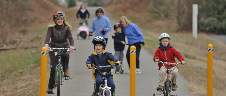 Families cycling and walking on a Spartanburg Trail.
