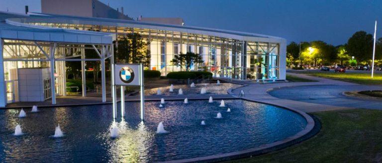 The exterior of BMW Zentrum at night.