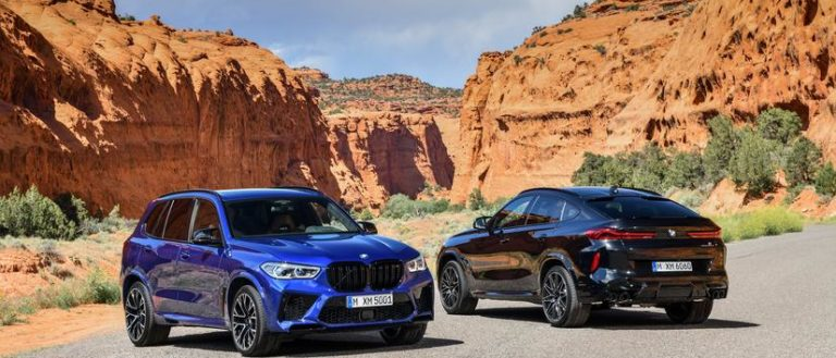 The 2020 BMW X5 M X6 M on a road in the desert.