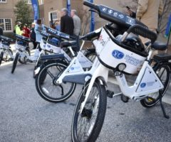 A row of BCycle electric bikes at an announcement ceremony.