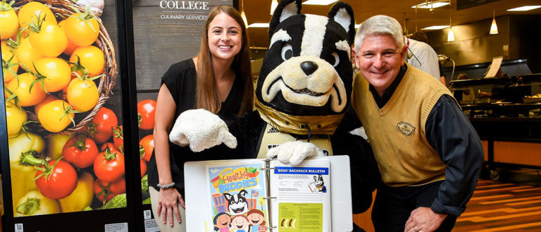 Wofford senior Caitlin Shealy with Dr. Dave Pittman and the Wofford College mascot.