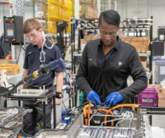 BMW workers assembling a PHEV battery.