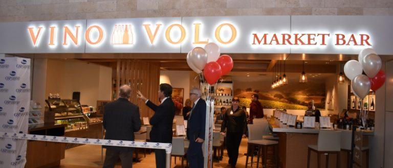 People standing inside a Vino Volo MarketBar.