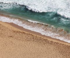 Waves hitting an empty beach.