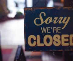"""A sign on a door that reads """"sorry we're closed."""""""