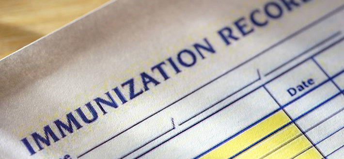 A piece of paper detailing immunization records.
