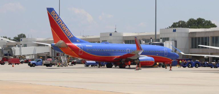 A Southwest plane taxiing on a tarmac.