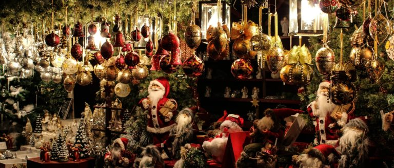 A wall of holiday ornaments.