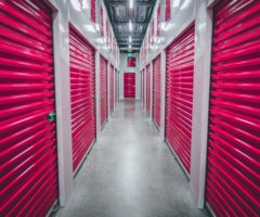 Indoor storage units with pink doors.