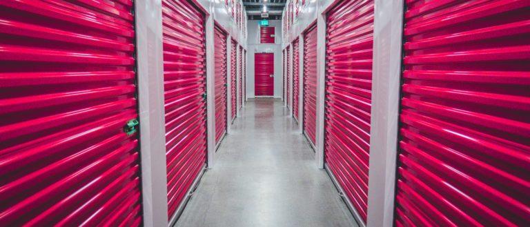 Indoor storage units with pink doors.